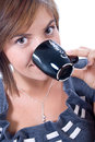 Young attractive woman drinks coffee Royalty Free Stock Images