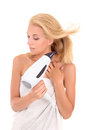 Young attractive woman drying her hair with hairdryer beautiful hairdryerb Stock Photo