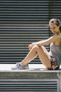 Young attractive woman exercise stretching in urban environment