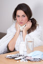 Young attractive woman fighting sickness with pills beautiful Royalty Free Stock Photo