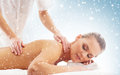 Young attractive woman getting spa treatment on the snow Royalty Free Stock Photo