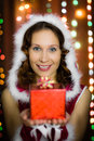 Young attractive woman with a gift Royalty Free Stock Photography