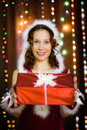 Young attractive woman with a gift Stock Photography