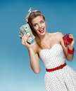 Young attractive woman holding united states dollar bills and happy smiling shopping concept retro with money having an idea how Stock Images