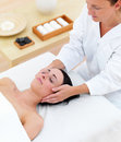 Young attractive woman receiving face massage Stock Image
