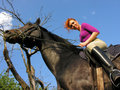 Young  attractive  woman riding in wild nature Royalty Free Stock Photo