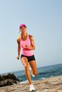 Young attractive woman running outdoors. Royalty Free Stock Photos
