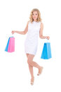 Young attractive woman with shopping bags in white dress isolated on white background Royalty Free Stock Image