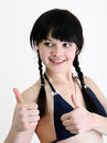 Young attractive woman showing thumb up symbol Royalty Free Stock Photo