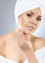 A young attractive woman in towel making the spa treatment close up portrait of beautiful and healthy with arrows on her face Stock Photos