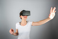 Young attractive woman using a virtual reality headset for first