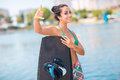 Young attractive woman with wakeboard brunette posing on the beach Royalty Free Stock Photo