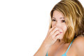 Young attractive woman who covers her nose looks away something stinks close up image of a very bad smell situation isolated on Royalty Free Stock Images