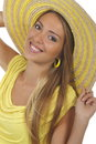 Young attractive woman with yellow shirt and strawhat isolated Stock Photography