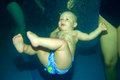 Young baby diving in the swimming pool Stock Images