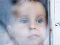 Young baby looking from window Royalty Free Stock Image