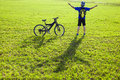 Young backpacker relaxing on a meadow with bicycle in the park Royalty Free Stock Photo