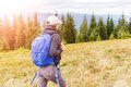 Young backpacker woman enjoying mountain trip Royalty Free Stock Photo