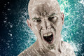 Young bald head man surrounded by splashing water advertising shot Royalty Free Stock Photo