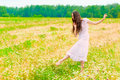 Young ballerina dancing in  field with daisies Royalty Free Stock Photo