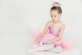 Young ballerina girl in a pink dress on a light background Royalty Free Stock Photos