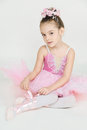 Young ballerina girl in a pink dress on a light background Stock Photography