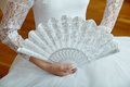 Young ballerina in white dress holding a white fan. Royalty Free Stock Photo
