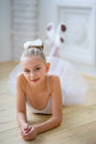 Young ballet dancer lying on the floor Royalty Free Stock Photo