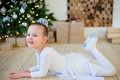 Young ballet dancer lying near Christmas tree Royalty Free Stock Photo