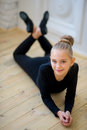 Young ballet dancer lying near the wall Royalty Free Stock Photo