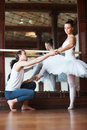 Young ballet trainer training a female dancer Stock Photos