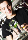 Young barman Stock Images