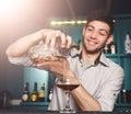 Young Barman mixing cosmopolitan cocktail Royalty Free Stock Photo