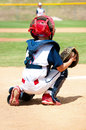 Young baseball catcher during game. Royalty Free Stock Photo