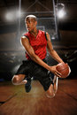 Young basketball player jumping inside a court Stock Images