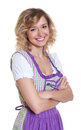 Young bavarian woman with curly blond hair on a isolated white background for cut out Royalty Free Stock Photo