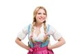 Young bavarian woman in dirndl isolated on white background Royalty Free Stock Photo