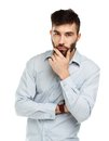 A young bearded man with a serious expression on his face isolat Royalty Free Stock Photo