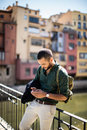 Young bearded traveller using his smartphone Royalty Free Stock Photo