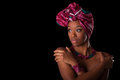 Young beautiful african woman wearing a traditional headscarf i over black background Royalty Free Stock Photography