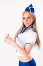 Young beautiful air hostess attractive stewardess showing thumb up gesture Stock Photo