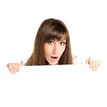 Young beautiful amazed woman holding blank white card Royalty Free Stock Photo