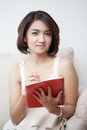 Young beautiful asia women holding book and pencil Royalty Free Stock Photo