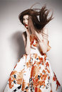 Young beautiful asian brunette in gorgeous dress motion shot Stock Photography