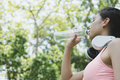 young beautiful asian fitness athlete woman drinking water after Royalty Free Stock Photo