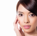 Young beautiful asian woman with flawless skin and perfect make up and brown hair sexy lipstick highlighter rouge on clear Royalty Free Stock Photography