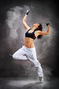 Young beautiful athletic woman dancing modern dance hip-hop Royalty Free Stock Photo