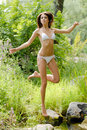 Young beautiful bikini woman in forest Royalty Free Stock Photos