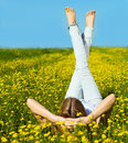 Young beautiful blond girl laying on the daisy flowers field summer fun concept Stock Photo