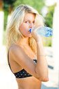 Young beautiful blond woman drinking water Royalty Free Stock Photo